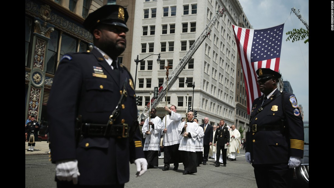 "The procession arrives at the annual Blue Mass on May 5. Law enforcement representatives gathered to continue the tradition of congregating annually ""to pray for their comrades who fell in the line of duty."""