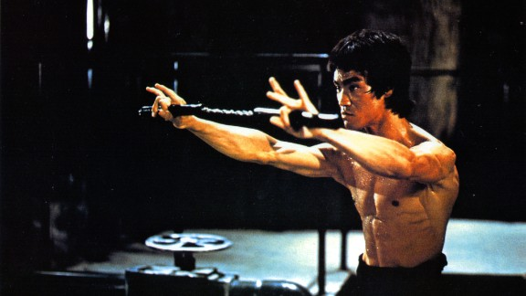 """Martial-arts actor Bruce Lee, seen here training in a scene from the film """"Enter the Dragon,"""" dies in July 1973 just days before the movie"""