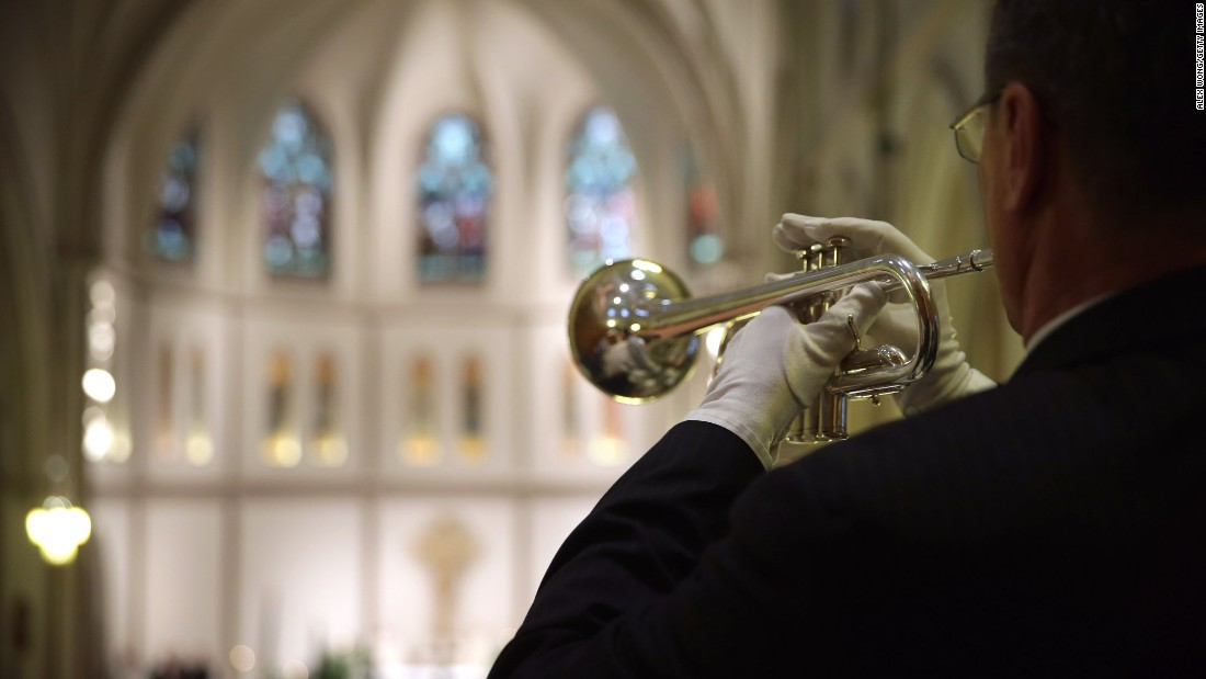 Taps is played during the Mass on May 5.
