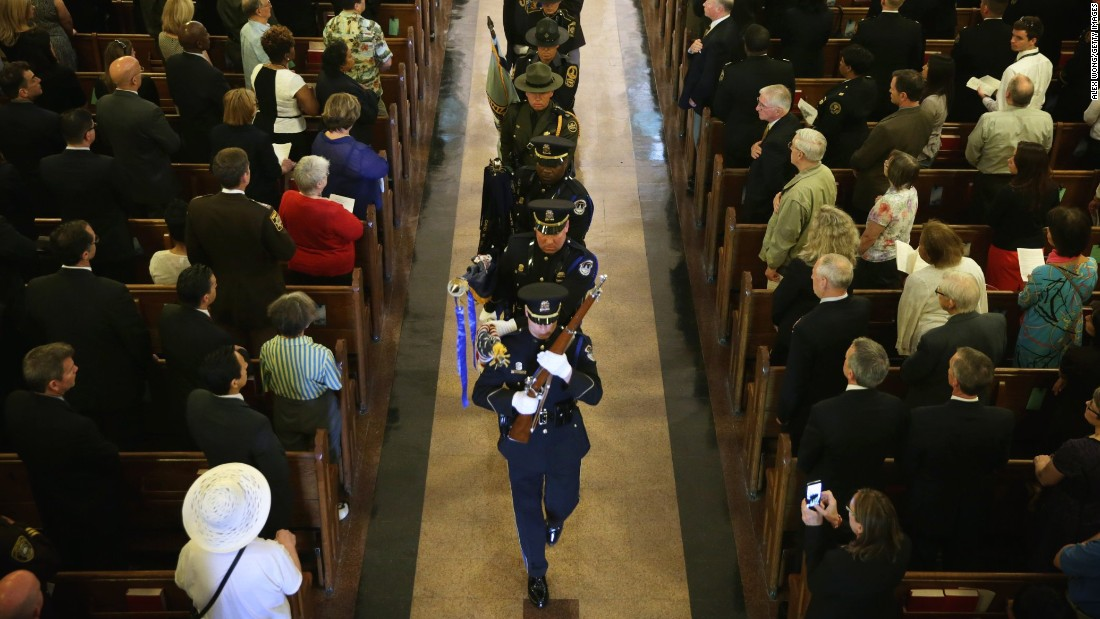 Members of the color guard exit St. Patrick's Catholic Church on May 5.