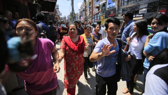 People in Kathmandu hurry along a street after the quake struck on May 12.