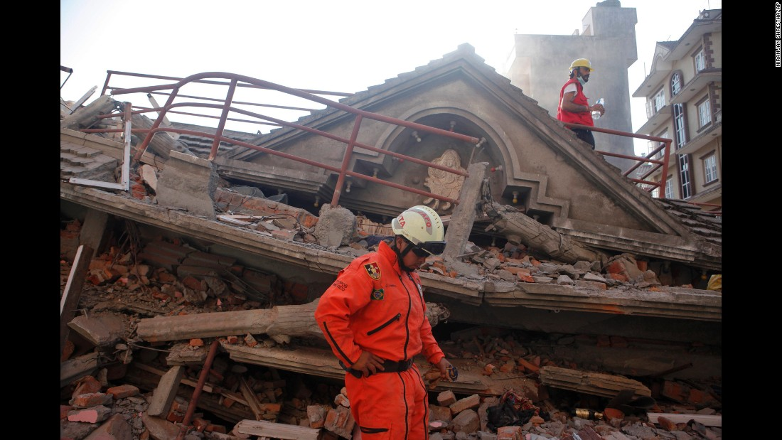 A rescue worker from Mexico stands at the site of a collapsed building in Kathmandu on May 12.