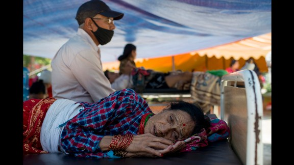 A woman rests at a makeshift hospital in Kathmandu on May 12.