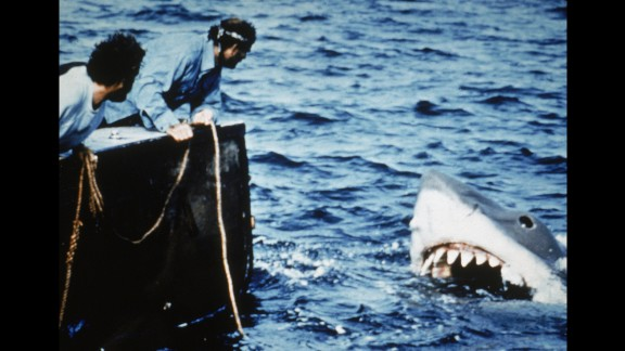 "In the summer of 1975, Steven Spielberg had people flocking to the theaters instead of the beaches. The success of ""Jaws"" -- his first hit movie -- set up summer as the season for Hollywood"
