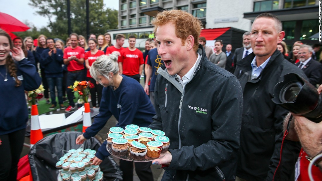 MAY 12 -- CHRISTCHURCH, NEW ZEALAND: Prince Harry helps the Student Volunteer Army hand out cupcakes during a visit to the University of Canterbury. The prince is in New Zealand attending events in Wellington, Invercargill, Stewart Island, Christchurch, Linton, Whanganui and Auckland.