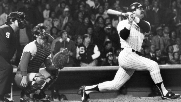 """Reggie Jackson of the New York Yankees hits his third home run of the game on October 18, 1977, leading the Yankees to a World Series win over the Los Angeles Dodgers. Jackson had a .357 batting average over the 27 World Series games throughout his career, earning him the nickname """"Mr. October."""" Jackson and the Yankees would repeat as World Series champions the following year."""