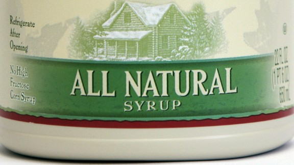 """A jug of Log Cabin syrup is seen in Montpelier, Vt., Thursday, Sept. 9, 2010.  Vermont officials are taking issue with the new Log Cabin """"All Natural Syrup"""" containing ingredients that may not be. U.S. Rep. Peter Welch wants the U.S. Food and Drug Administration to investigate whether the company is violating FDA labeling laws. A Log Cabin representative is defending the labeling as proper.  The new product, which is being sold in jug containers similar to those used by Vermont maple producers, contains xanthan gum, caramel color and citric acid.  (AP Photo/Toby Talbot)"""