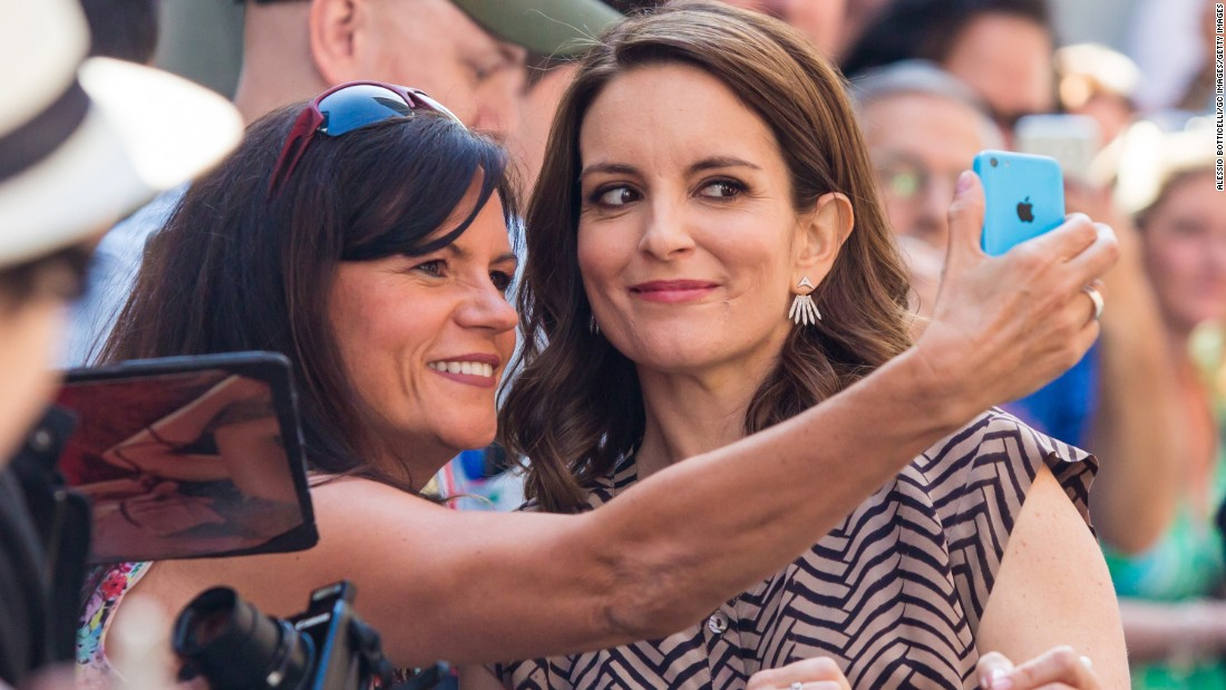 "Actress Tina Fey stops for a fan's photo in New York on Thursday, May 7. Fey was appearing on the ""Late Show with David Letterman."""