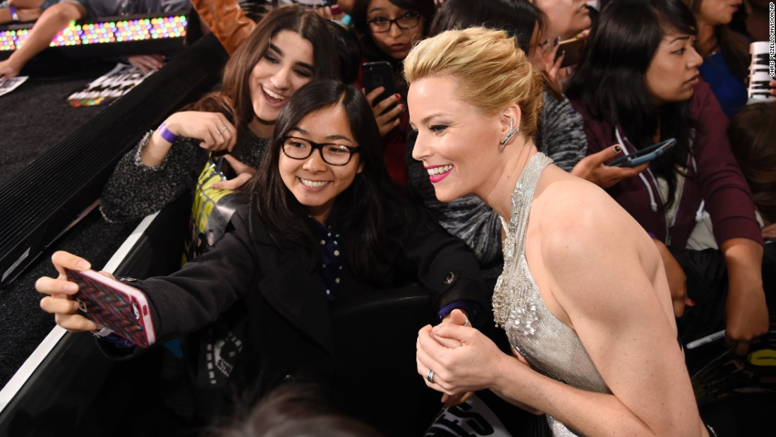 "Actress Elizabeth Banks, director of ""Pitch Perfect 2,"" poses with fans at the film's premiere in Los Angeles on Friday, May 8."