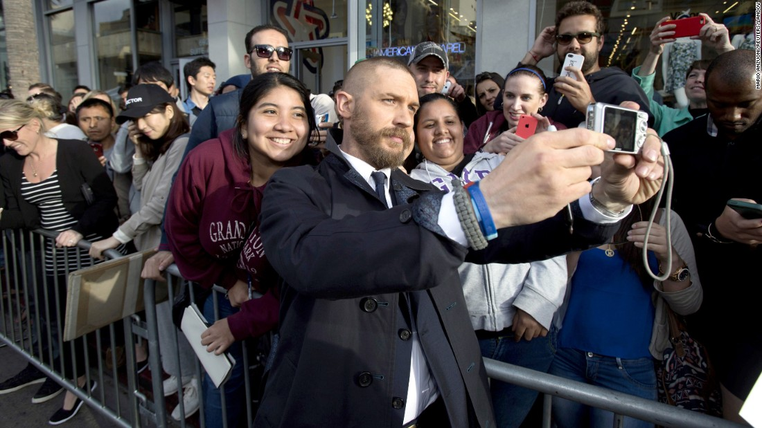 "Actor Tom Hardy takes a selfie with fans in Hollywood at the premiere of ""Mad Max: Fury Road"" on Thursday, May 7."