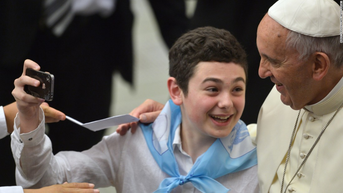 Pope Francis poses for a boy's selfie during an audience at the Vatican on Thursday, May 7.