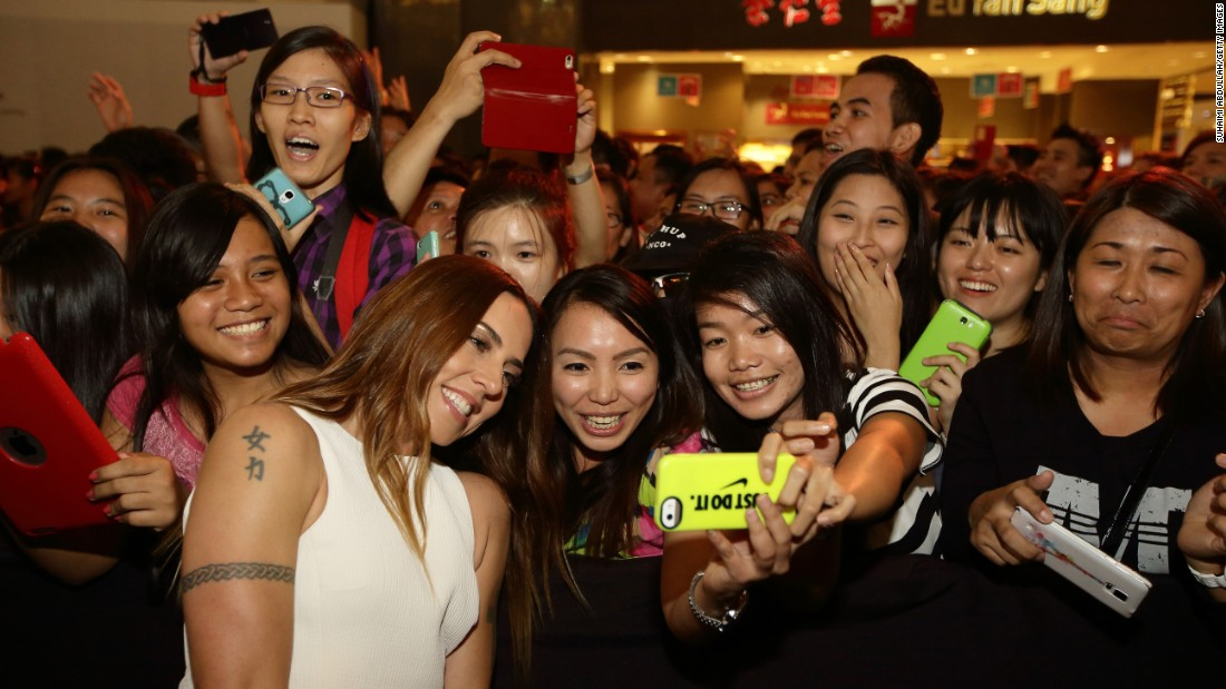 "Fans in Singapore take a selfie with singer Melanie Chisholm, one of the former Spice Girls, during an ""Asia's Got Talent"" showcase on Friday, May 8."