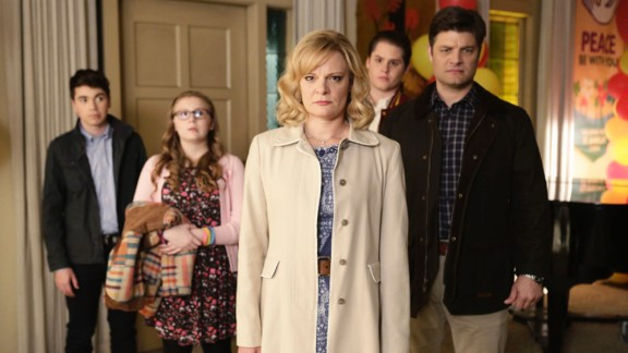 "The uptight family in ""The Real O'Neals"" suddenly find themselves being more honest with each other after one of them comes out. The ABC comedy will star Martha Plimpton, center."