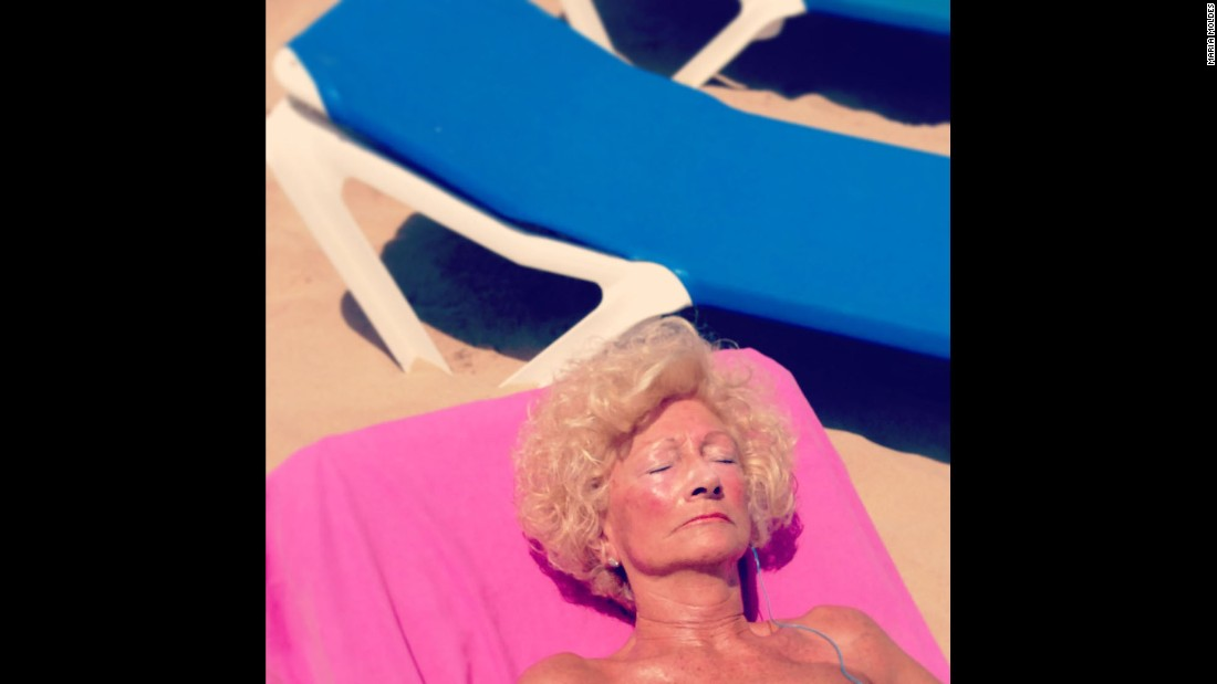 "A woman sunbathes in the Spanish town of Benidorm, a beach haven for many working-class tourists and pensioners from northern Europe. ""Scenes of Radioactive Life"" is Maria Moldes' two-year photographic ode to Benidorm, highlighting the extravagance of the place and its characters. ""It is an endless source of images,"" she said."