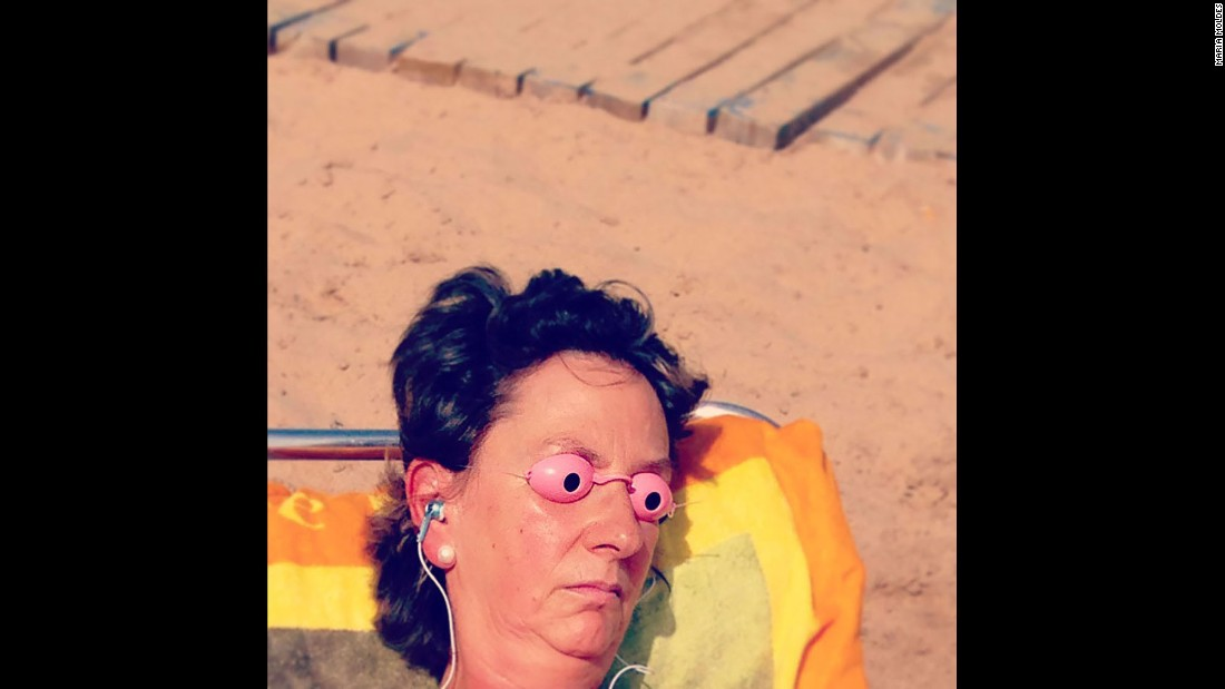 A woman uses protective eyewear while tanning.