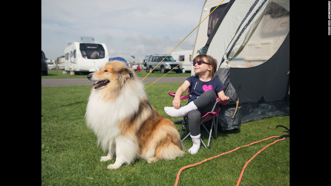 A girl and a dog relax at a caravan site in Somerset, England.