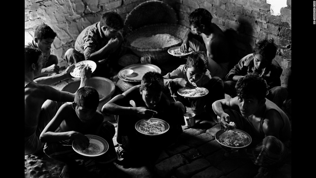 Young brickyard workers eat lunch in Chittagong.