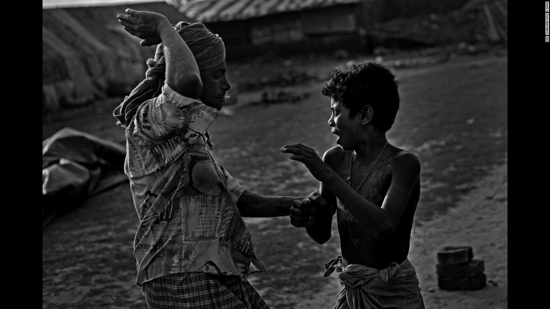 Shafik, 11, is beaten by his master, Khan said, at a brickyard in Chittagong. The child was accused of playing when he was supposed to be working.