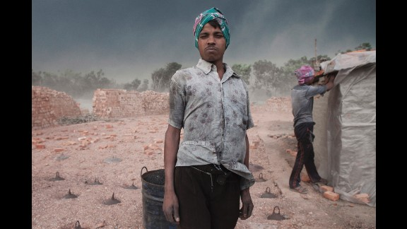 A worker poses for a photo before a sandstorm hits a brick factory in Dhaka, Bangladesh.