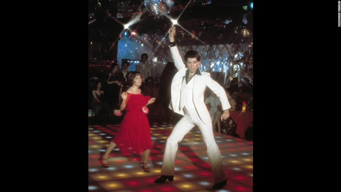 "Disco music sweeps the nation with the 1977 film ""Saturday Night Fever"" starring John Travolta. Catapulted by a soundtrack containing five No. 1 singles -- including ""Staying Alive"" and ""Night Fever"" -- the film became a huge commercial success. The soundtrack stayed on top of the album charts for six months, and Travolta earned an Academy Award nomination for Best Actor."