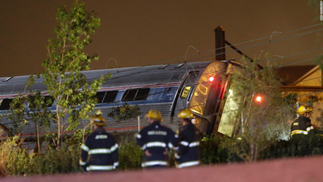 Emergency personnel work the scene of the train wreck on May 12.