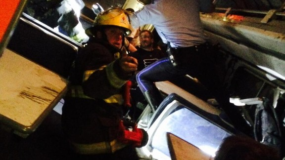 """Former U.S. Rep. Patrick Murphy tweeted he was aboard the train when it crashed. """"Helping others,"""" he said. """"Pray for those injured."""" Later he shared this photo that showed a firefighter inside the train."""