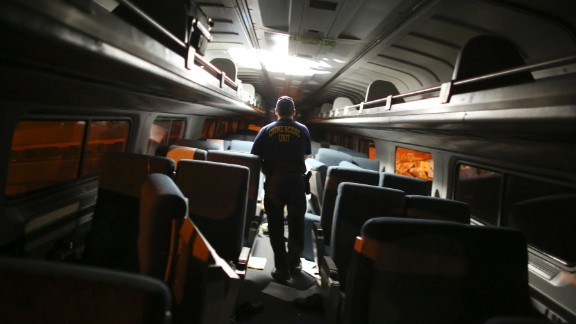 A crime scene investigator looks inside a train car on May 12.
