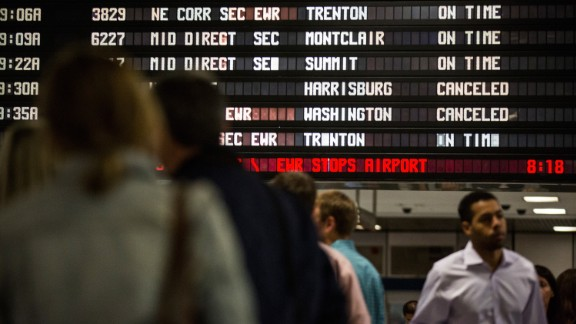 The Amtrak information board in New York shows the derailed train as canceled on May 13.