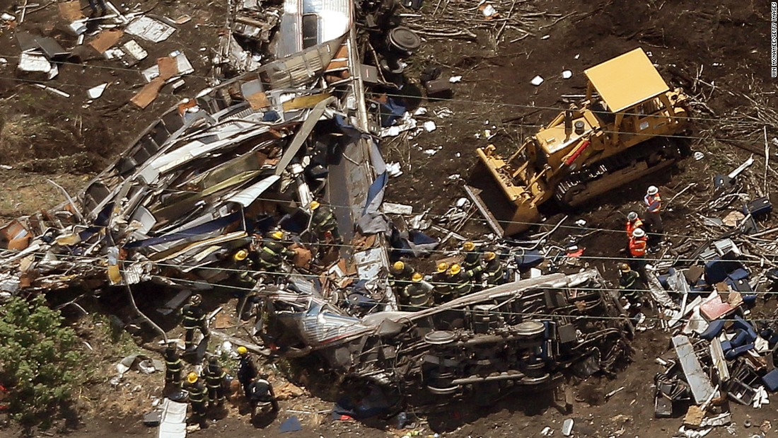 Crews work amid the wreckage on May 13.