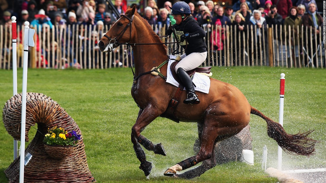 Britain's Pippa Funnell, regarded as one of three-day eventing's sporting elite, approaches a jump on horse Redesigned. They came in 12th place at the end of the championship.