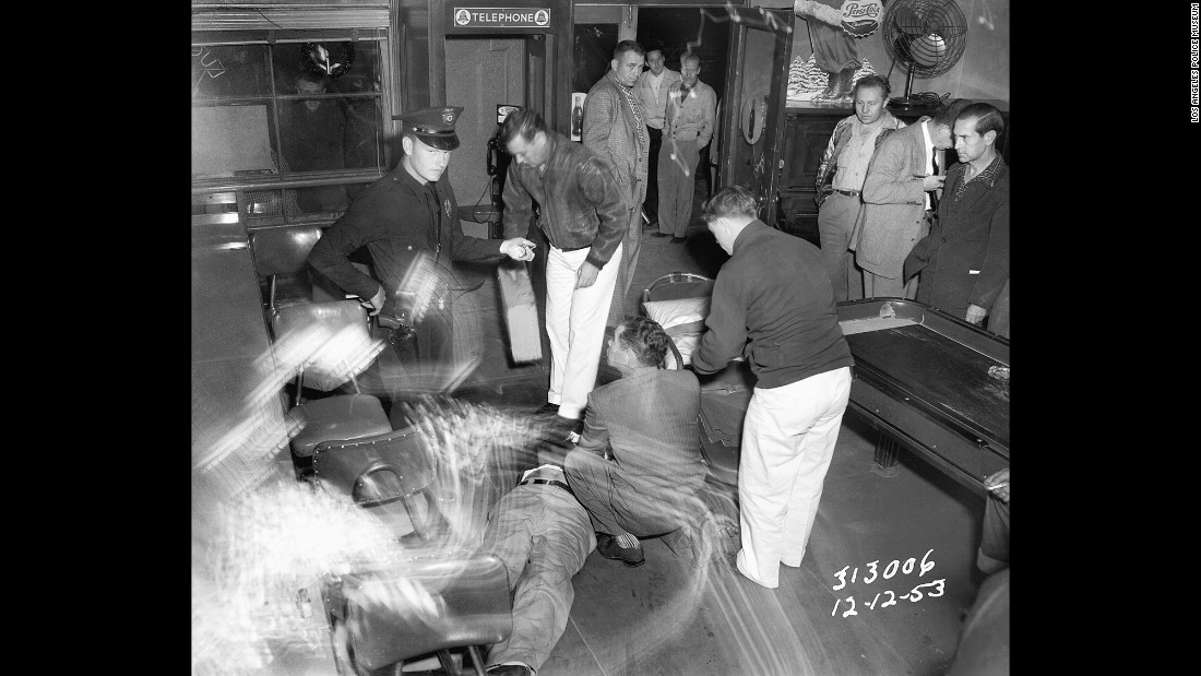 "Members of the Los Angeles Police Department work at the scene of a shooting in December 1953. Award-winning crime writer James Ellroy, author of books such as ""The Black Dahlia"" and ""L.A. Confidential,"" has teamed up with the Los Angeles Police Museum on <a href=""http://abramsbooks.com/Books/LAPD__53-9781419715853.html"" target=""_blank"">""LAPD '53,""</a> a new book that looks at law enforcement in the city more than 60 years ago. The book will be released on Tuesday, May 19."