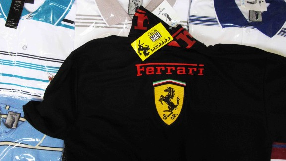 """""""OK, this is a copy, not real, but no problem,"""" a cheerful Thai woman says, pointing to a black knit polo shirt emblazoned with a Ferrari logo in Bangkok's wholesale and retail Pratunam Market."""
