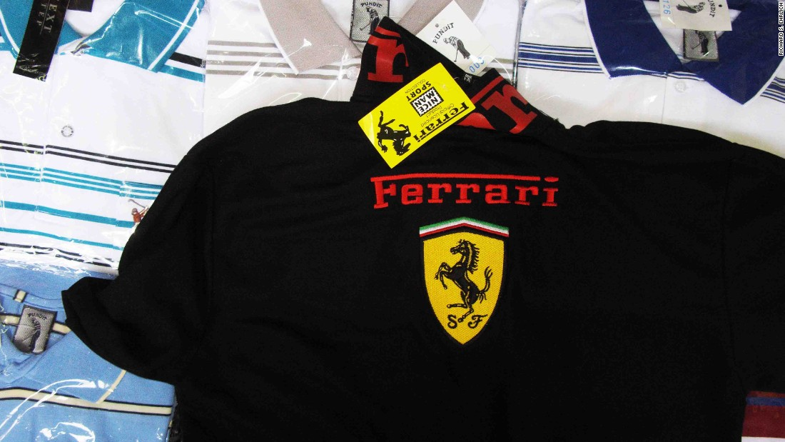 """OK, this is a copy, not real, but no problem,"" a cheerful Thai woman says, pointing to a black knit polo shirt emblazoned with a Ferrari logo in Bangkok's wholesale and retail Pratunam Market."