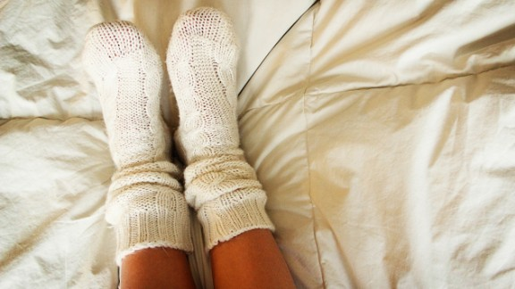 Did you know that having warm feet can help you sleep? Pull on a pair of socks before bed to speed up how quickly you