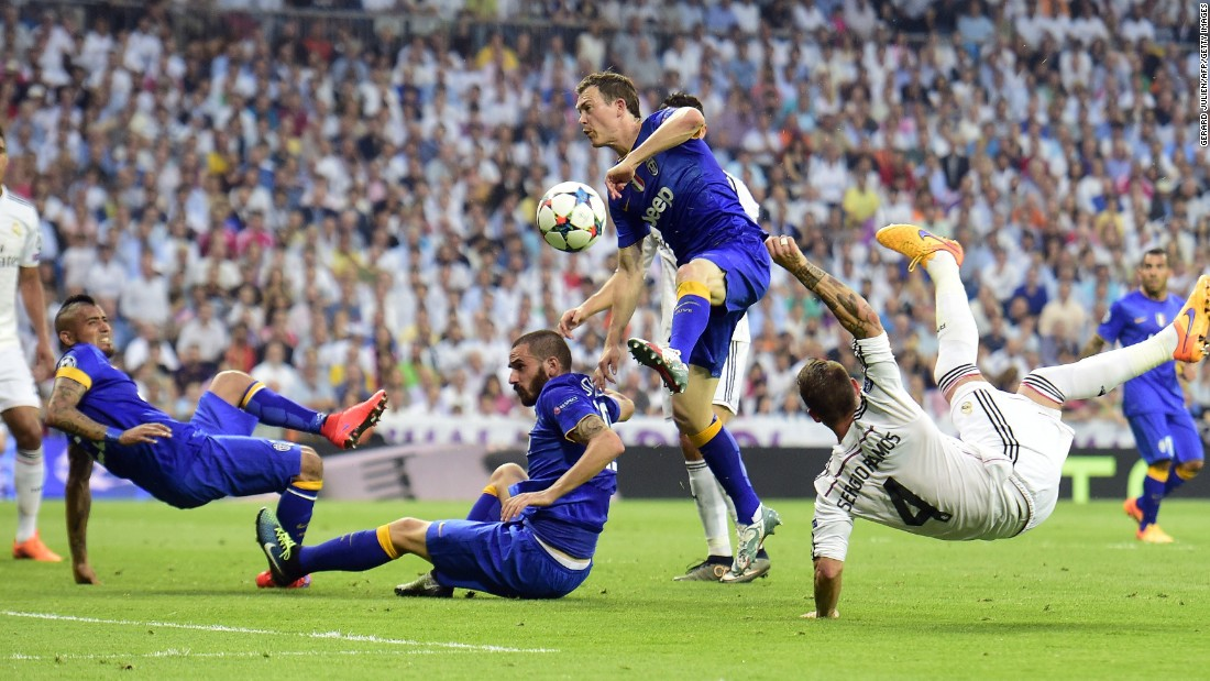 The match produced some frantic action -- here Ramos (right) launches a spectacular kick past Juventus' Leonardo Bonucci, Stephan Lichtsteiner and Arturo Vidal.