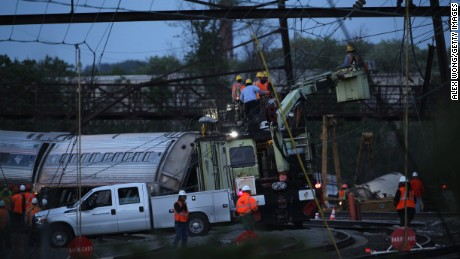 Caption:PHILADELPHIA, PA - MAY 13: Repair crews inspect damages at the site of a train derailment accident May 13, 2015 in Philadelphia, Pennsylvania. Service has been interrupted after an Amtrak train derailed in Philadelphia last night, killing at least seven people and injured more than 200. (Photo by Alex Wong/Getty Images)