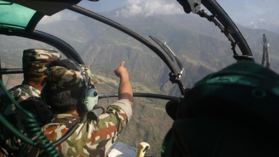 Members of the Nepalese Army search for a U.S. Marine helicopter in Nepal's Dolakha District on Thursday, May 14. The chopper went missing with six U.S. Marines and two Nepali service members on board. Three bodies were found in the helicopter's wreckage on Friday, Nepal's defense secretary said.