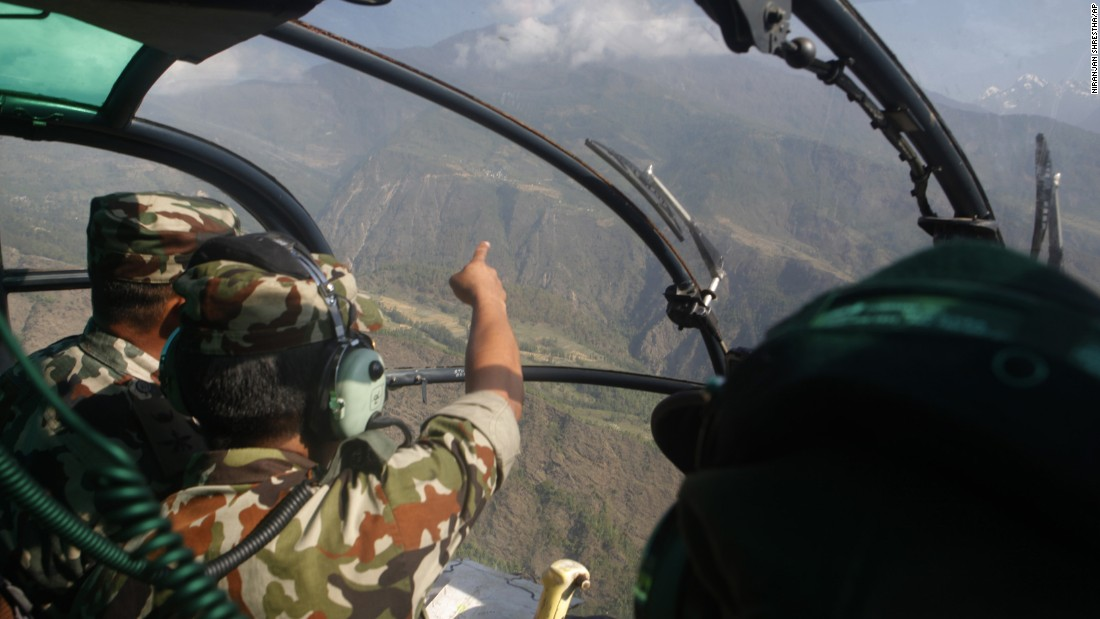 "Members of the Nepalese Army search for a U.S. Marine helicopter in Nepal's Dolakha District on Thursday, May 14. The chopper went missing with six U.S. Marines and two Nepali service members on board.<a href=""http://www.cnn.com/2015/05/15/asia/us-helicopter-found-nepal/index.html""> Three bodies were found in the helicopter's wreckage</a> on Friday, Nepal's defense secretary said."
