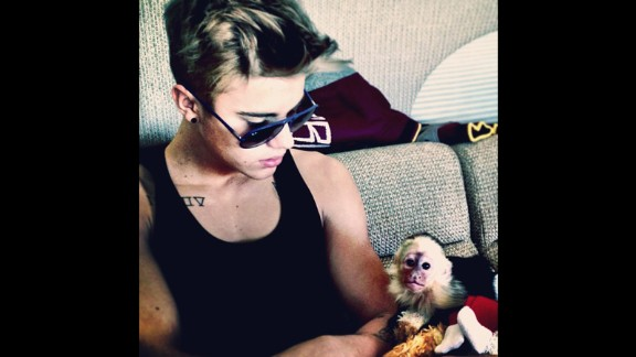 """Justin Bieber poses with his pet capuchin monkey, """"Mally,"""" in a photo he posted on Instagram. The monkey was seized by German customs officials in March 2013 after the singer brought it on tour without the right paperwork."""