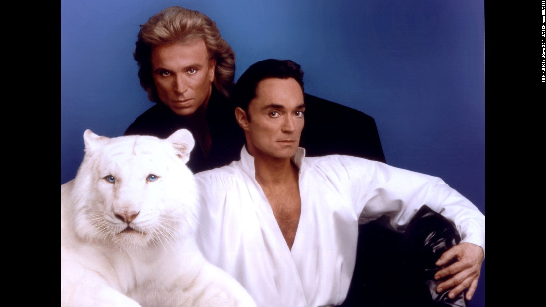 "Illusionists Siegfried and Roy pose with their white tiger in this undated photo at The Mirage casino hotel in Las Vegas. <a href=""http://cnn.com/2014/03/26/showbiz/siegfried-roy-tiger/"">A tiger lunged at Roy Horn's neck</a> halfway through a sold-out performance in October 2003, putting the entertainer in a critical condition, but thankfully he survived."