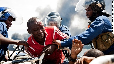 A man is lifted by police during a protest in Bujumbura on May 13, 2015. A top Burundian general announced today the overthrow of President Pierre Nkurunziza, following weeks of violent protests against the president's bid to stand for a third term.