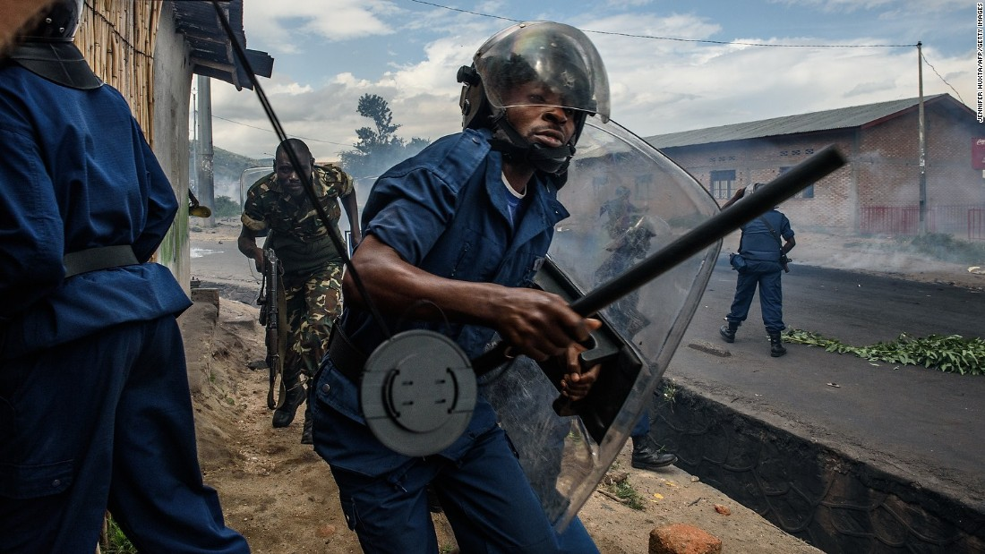 Burundi police and army forces run on May 13 after protesters threw stones during a demonstration in Bujumbura.