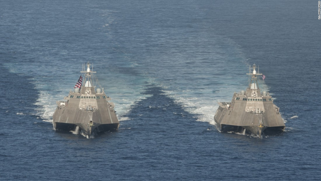 The USS Independence (LCS 2), left, and USS Coronado (LCS 4) steam in the Pacific Ocean. The two are of the Independence variant LCS. Ships of this variant are 416.8 feet in length with a beam of 103.7 feet and a displacement of 3,100 metric tons.