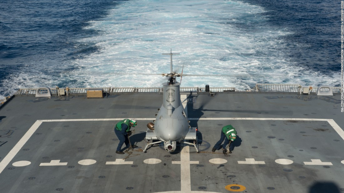 Sailors assigned to Helicopter Maritime Strike Squadron (HSM) 35 prepare an MQ-8B Fire Scout unmanned aircraft system for flight operations aboard the littoral combat ship USS Fort Worth (LCS 3).
