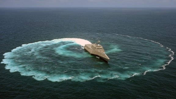 "The littoral combat ship USS Independence (LCS 2) demonstrates its maneuvering capabilities in the Pacific Ocean off the coast of San Diego. LCS crew commander John Kochendorfer described the ships as ""a military jet ski with a flight deck and a gun."""