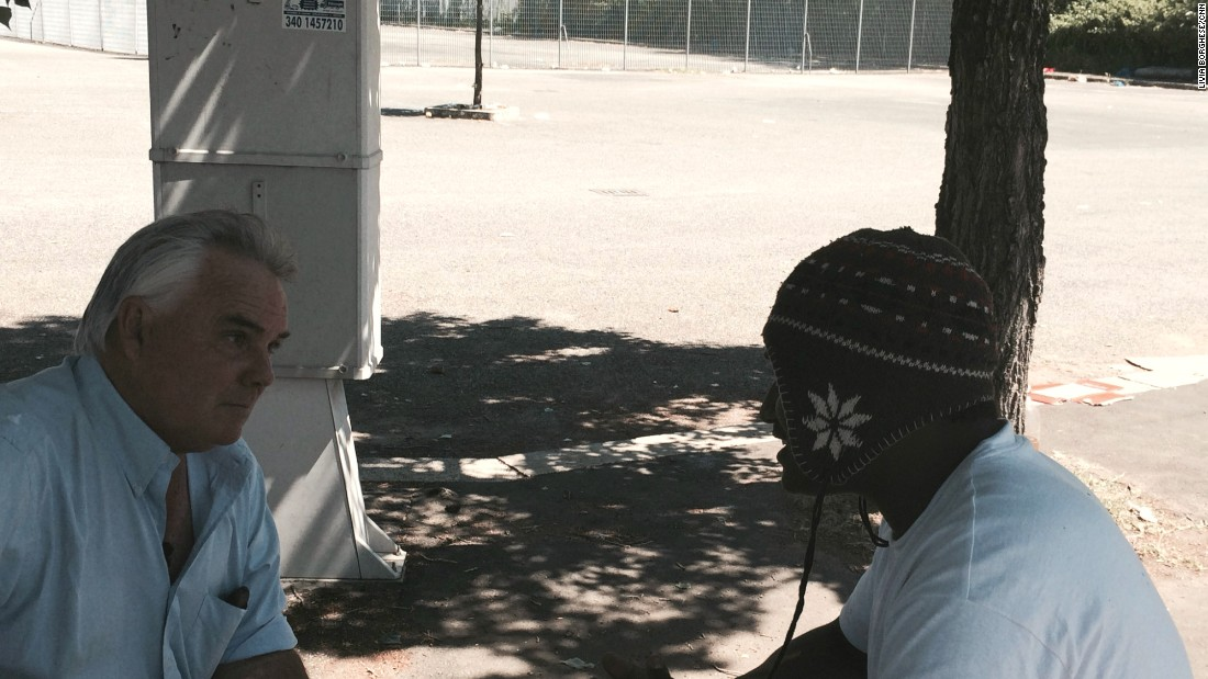 CNN International correspondent Ben Wedeman (L) with Benjamin, an Eritrean migrant in a park in Ponte Mammolo in northern Rome. He was one of a very few migrants in park who would agree to an interview.