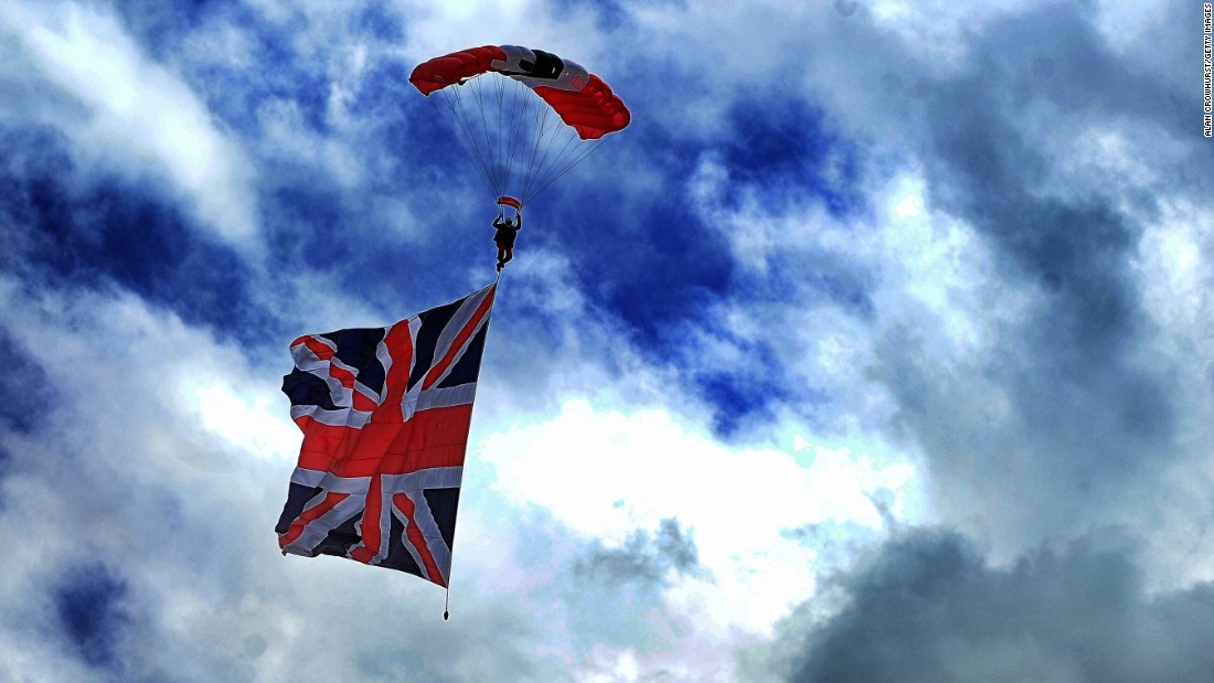 The Red Devils parachute team mark the start of the race as they swoop down on the course last year complete with a Union Jack.