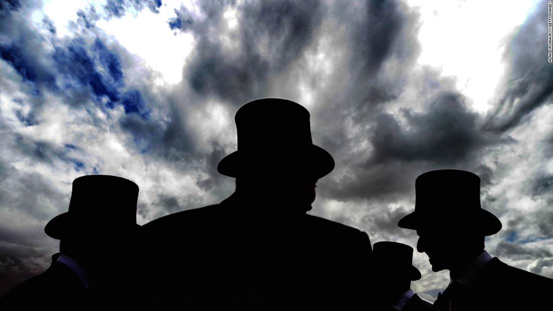 Top hats and tails are in order for gentlemen on race day at Epsom, a short train ride from London.