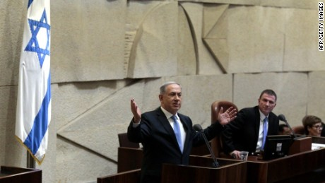 Israeli Prime Minister Benjamin Netanyahu speaks at the Knesset, Israel's Parliament, as he presents his proposed government for a confidence vote on May 14, 2015, in Jerusalem. Netanyahu's new administration marks a shift to the right by giving increased prominence to Naftali Bennett's far-right Jewish Home, which opposes a Palestinian state and strongly backs settlement activity. AFP PHOTO / POOL / JIM HOLLANDERJIM HOLLANDER/AFP/Getty Images
