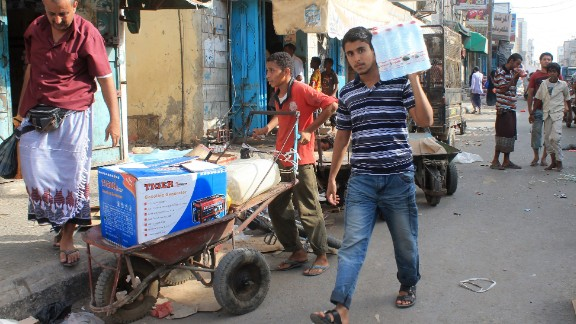 Yemenis purchase goods in the Sheikh Othman area, in the southern Yemeni port city of Aden, on May 13, 2015. King Salman doubled Saudi Arabia